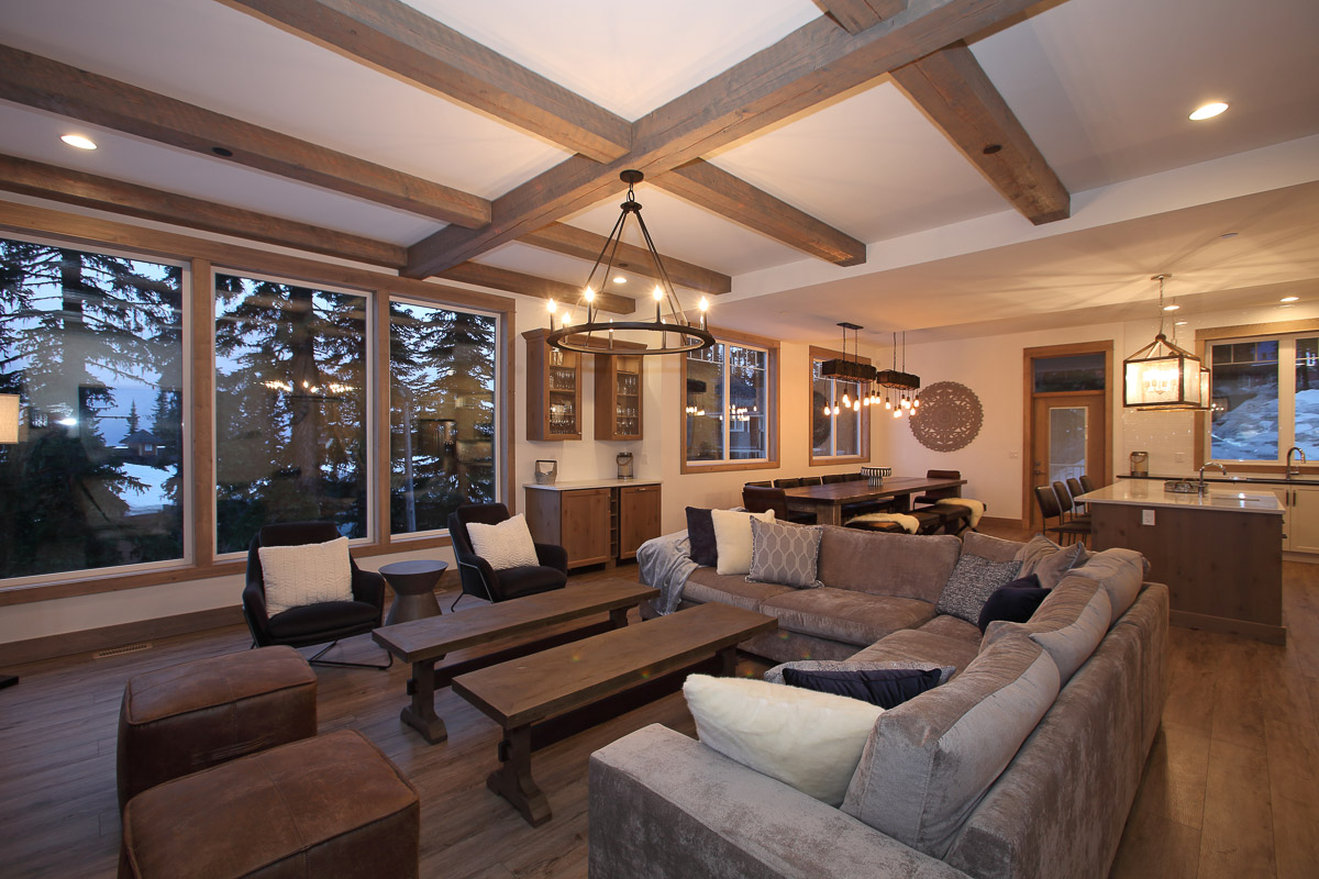 open concept modern living and dining room in a custom built home at silver star mountain resort in vernon bc
