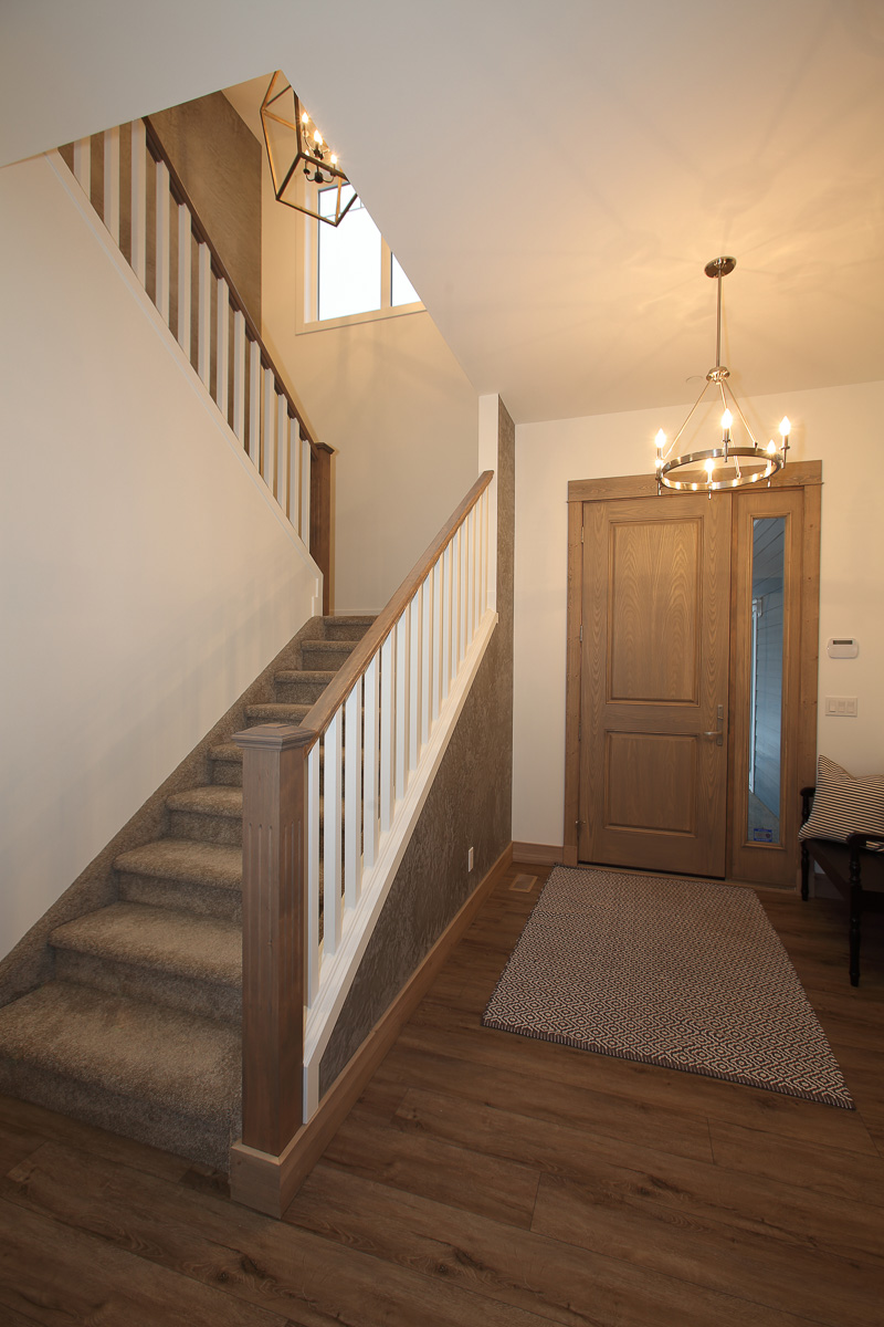 large, high-ceilinged entryway of a custom-built home by parsons family homes at silver star mountain resort