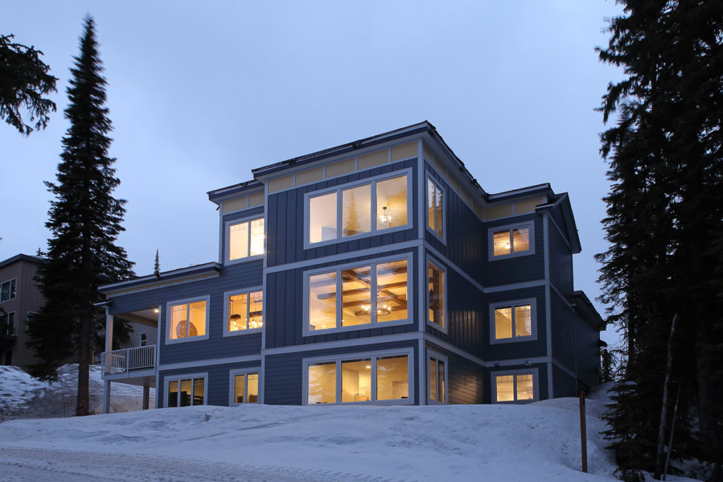 the outside of a custom-built blue silver star mountain resort home by parsons family homes builders in vernon, bc
